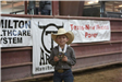 Boy showing off his Mutton Busting medal